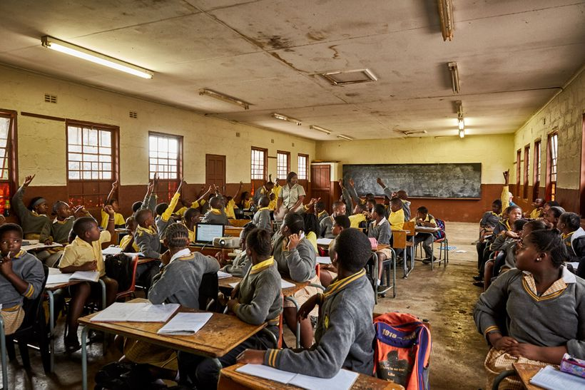 Students wait to answer Bush Babies education officer Lewyn Maefala's question, Phalaborwa Primary School, South Africa, 2017