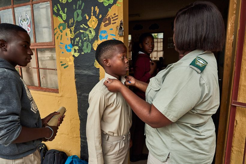 Every student's attendance record and appearance are checked before class starts, Mhala Mhala Primary School, South Africa, 2