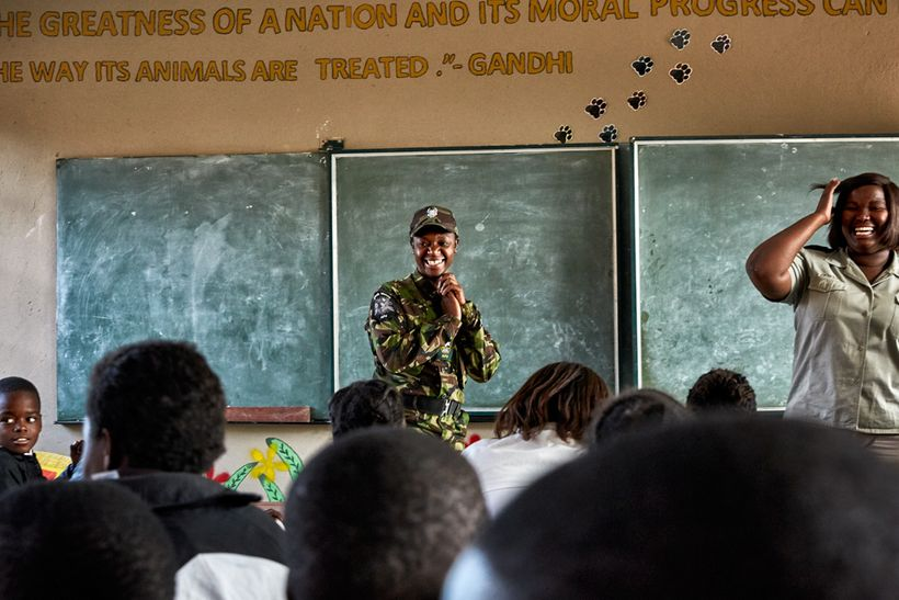 Black Mamba scout Nkateko Mzimba and Bush Babies education officer Lewyn Maefala laugh after realizing that three of the stud
