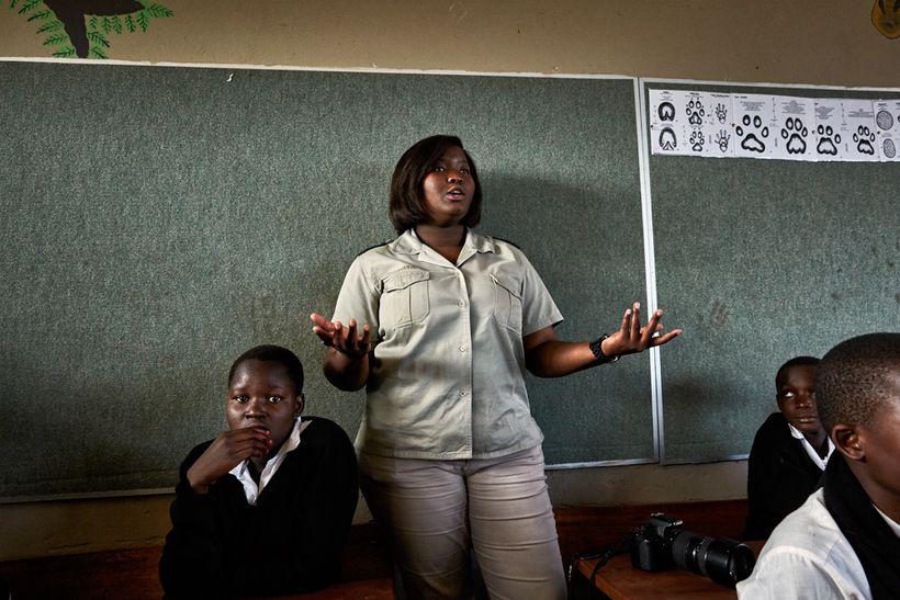 Bush Babies education officer Lewyn Maefala talks to children at Maseke Primary School, South Africa, 2017.