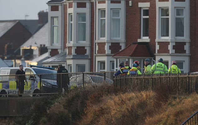 Members of the emergency service attend the scene at Brown's Bay after a body was found on the