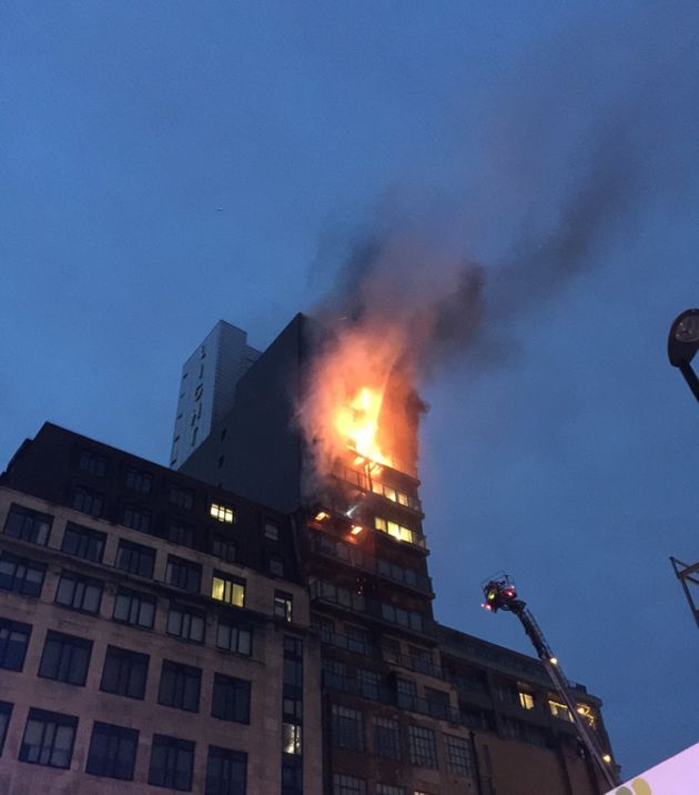 A fire broke out in a 12-storey building in Joiner Street, central Manchester, on