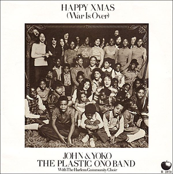 """Happy Xmas (War Is Over)"" record sleeve. Producer Phil Spector is visible on the top left, standing next to May Pang, John a"