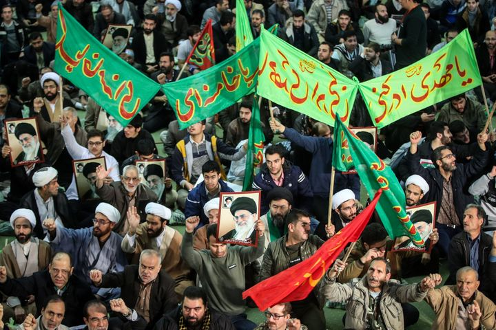 Iranians chant slogans as they march in support of the government near the Imam Khomeini grand mosque in the capital Tehran o