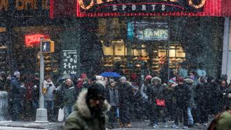 People walk around Times Square as a cold weather front hits the region, in Manhattan, New York, U.S., December 30, 2017. REUTERS/Eduardo Munoz