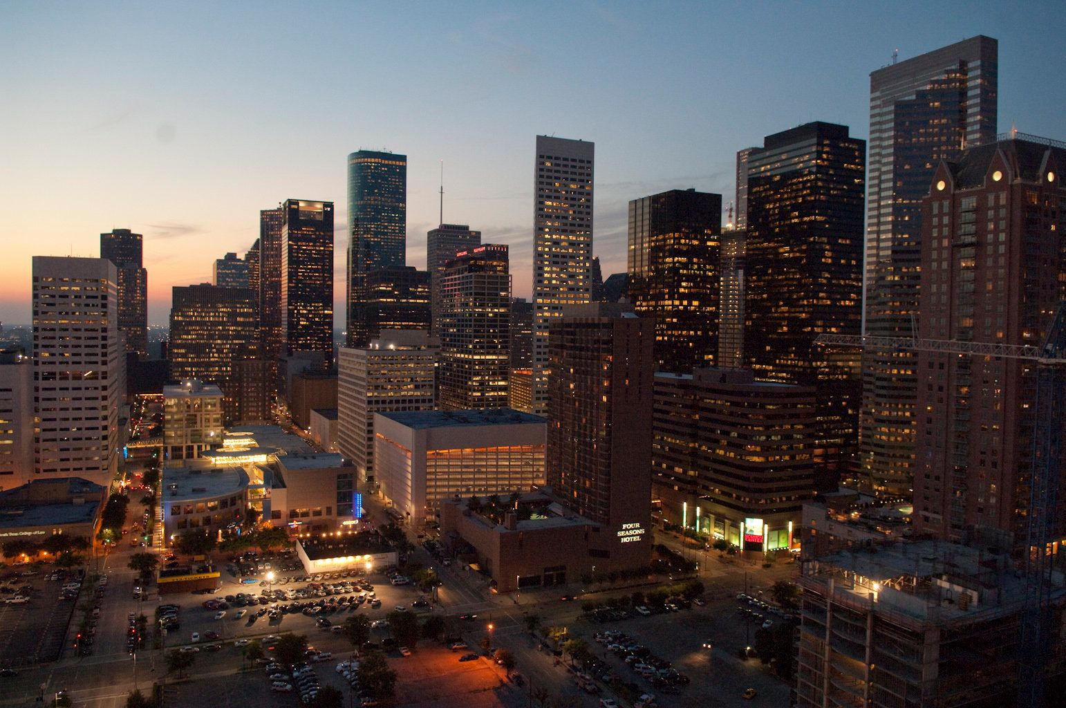 The Houston downtown skyline looking west from the 16th floor of the Hyatt Hotel, next door to the Toyota Center arena where the Houston Rockets NBA team have their home court.  (Photo by Robert Daemmrich Photography Inc/Corbis via Getty Images)
