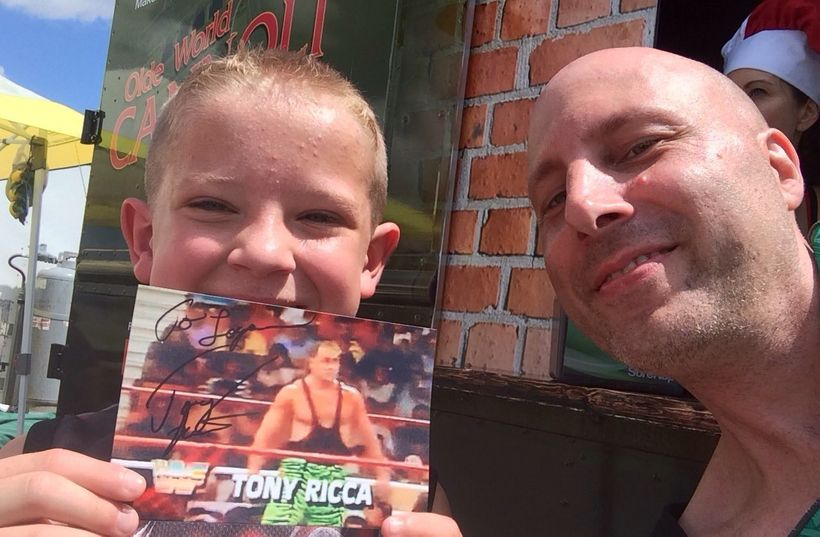 Tony Ricca with a young fan.