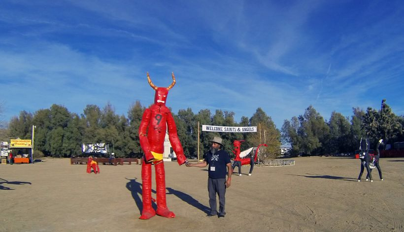 Festival founder Rolo Castillo chilling with one of his devil creations.