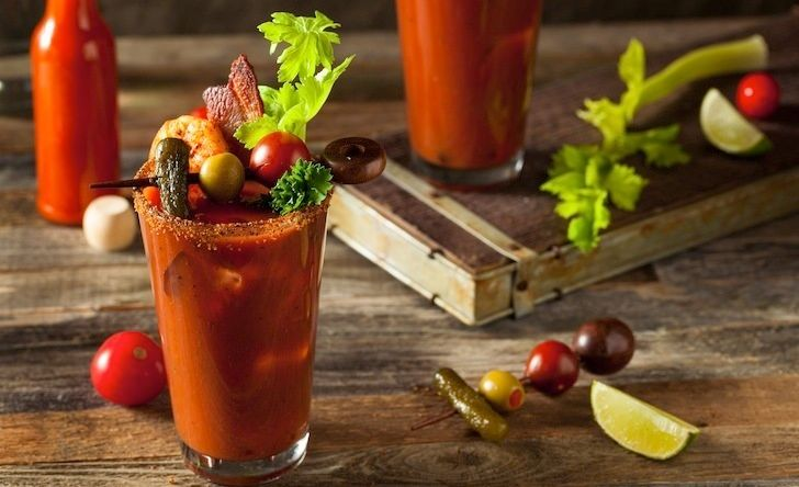 The Bloody Mary garnishes in this photo may be traditional, but the smoked flavor of the drink brings a new twist to the popu