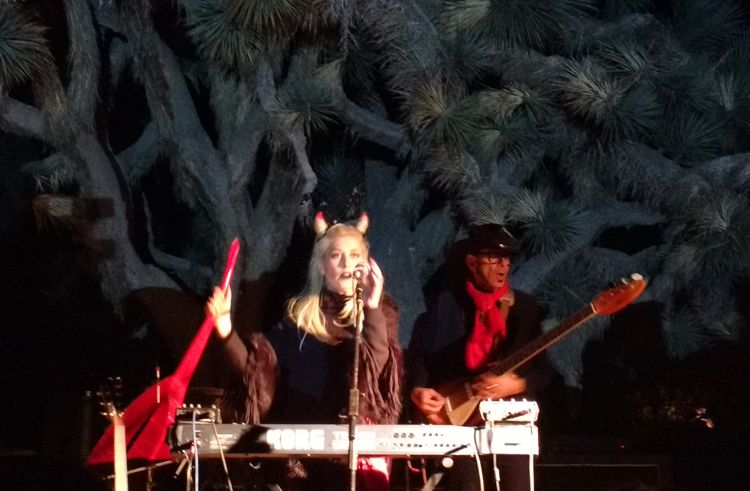 Jesika Von Rabbit performs on the Quema Stage in front of a staturesque joshua tree.