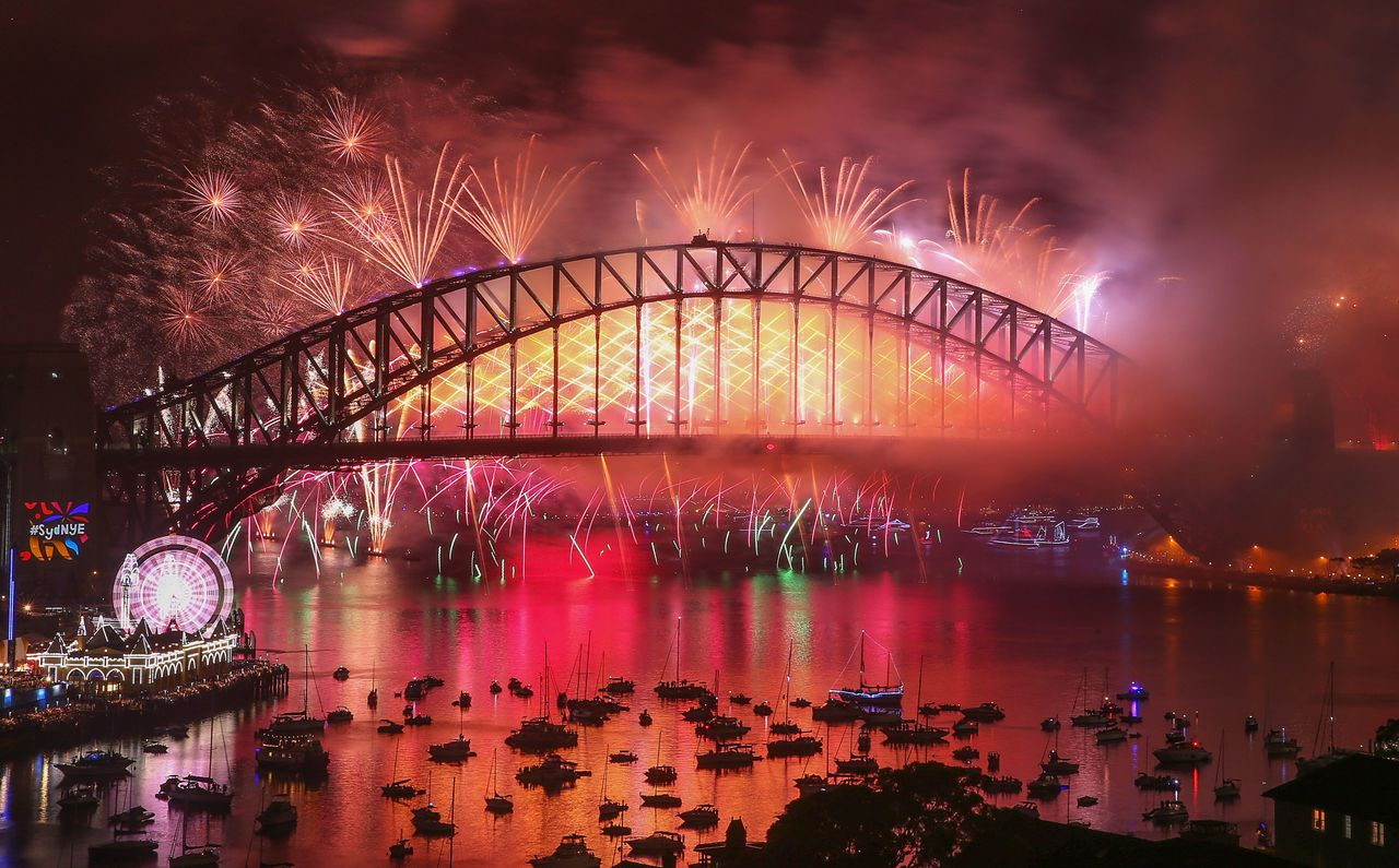 Fireworks explode from the Sydney Harbour Bridge and the Sydney Opera House during the midnight fireworks display on New Year's Eve on January 1, 2018 in Sydney, Australia.