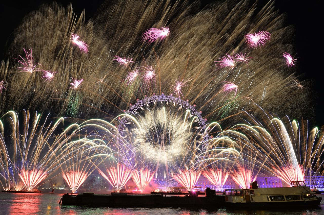 Fireworks light up the sky over the London Eye in central London during New Year's celebrations.