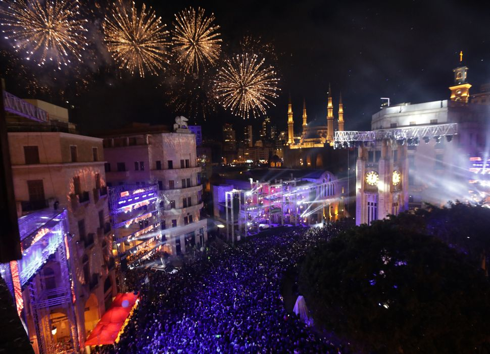 Fireworks explode over downtown Beirut, Lebanon during New Year's celebrations on January 1, 2018.