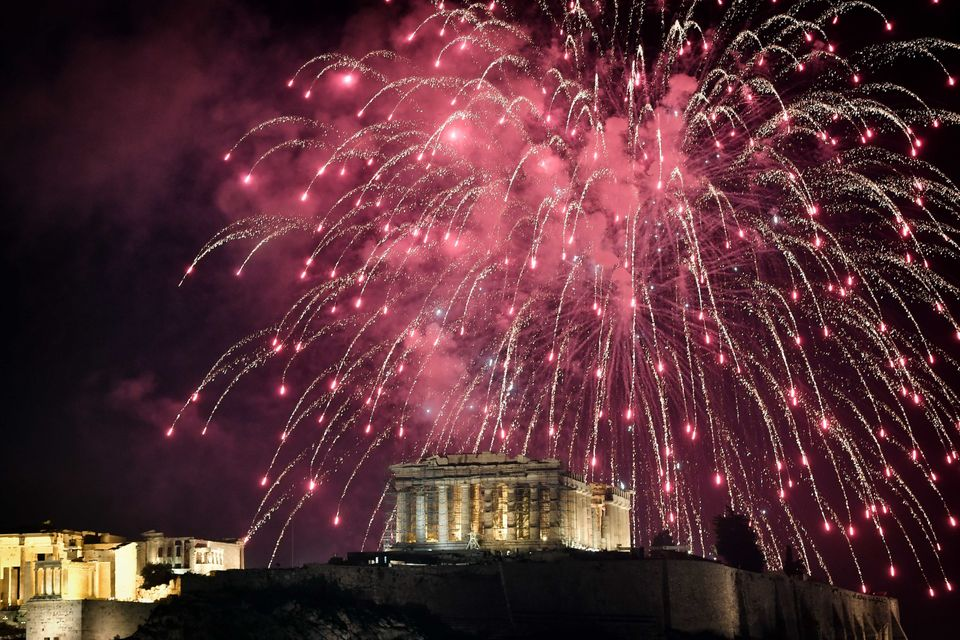 Fireworks explode over the Acropolis in Athens during New Year's celebrations on December 31,