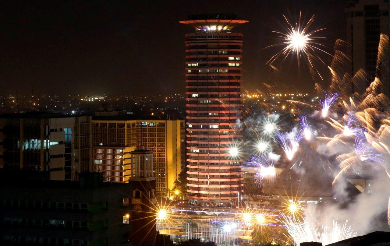 Fireworks explode over the Kenyatta International Convention Center square during New Year's celebrations in Nairobi, Kenya on January 1, 2018.