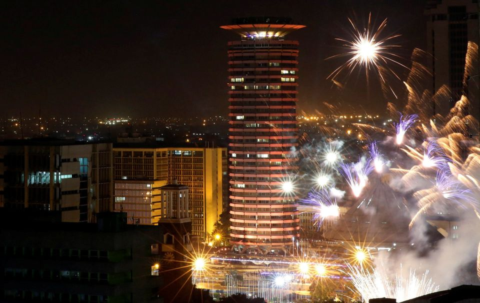 Fireworks explode over the Kenyatta International Convention Center square during New Year's celebrations...