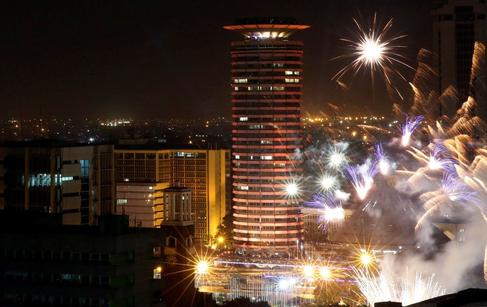 Fireworks explode over the Kenyatta International Convention Center square during New Year's celebrations in Nairobi, Kenya o