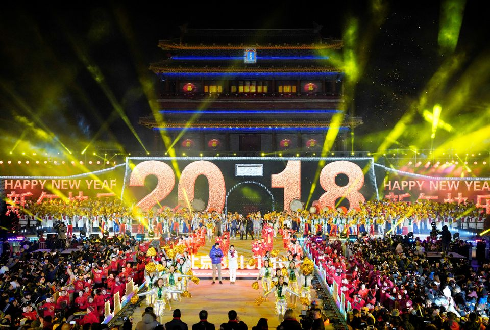 People celebrate the New Year during a countdown event at Yongdingmen Gate in Beijing, China on January...