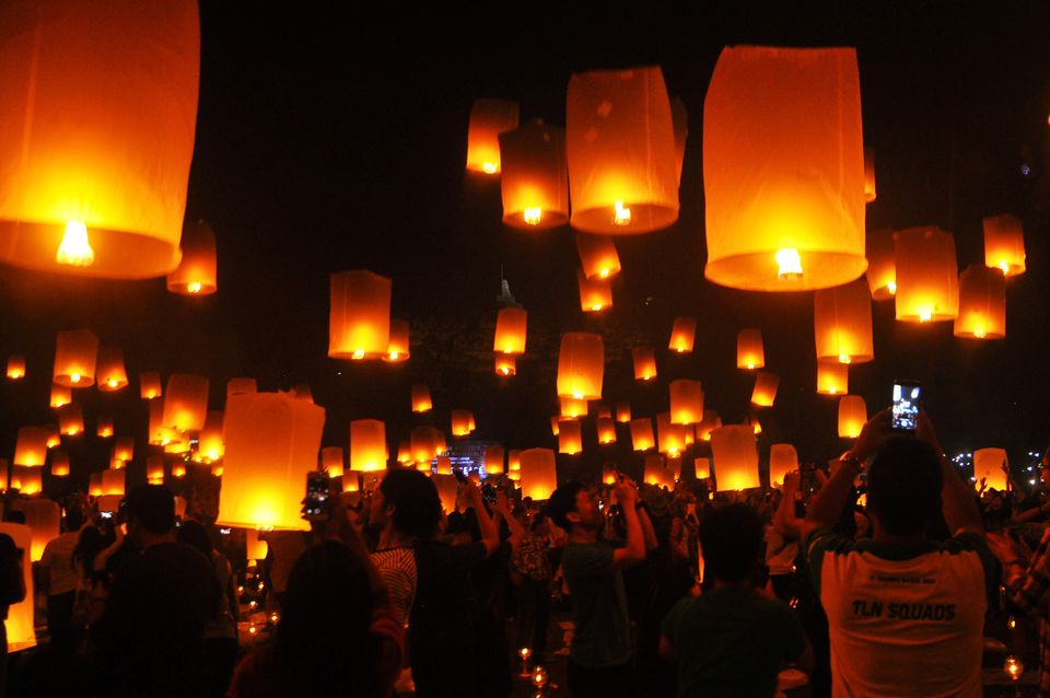 People fly lanterns at Borobudur Temple during New Year's celebrations in Magelang, Indonesia on January...