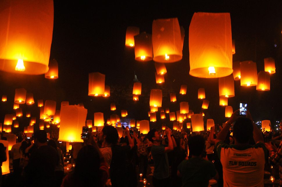 People fly lanterns at Borobudur Temple during New Year's celebrations in Magelang, Indonesia on January 1, 2018.