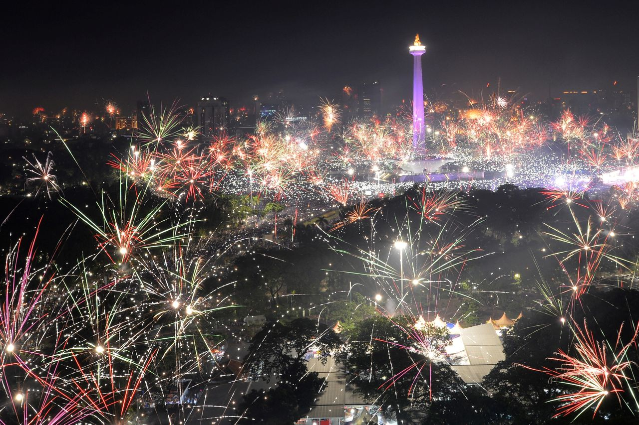 Fireworks explode around the National Monument during New Year's celebrations in Jakarta, Indonesia on January 1, 2018.