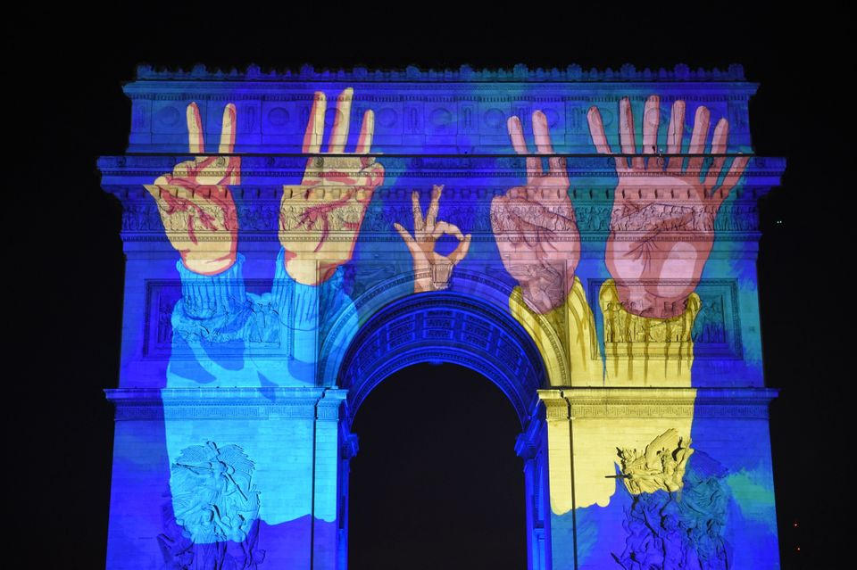 Images are projected on the Arc de Triomphe monument during a laser and 3D video mapping show as part...
