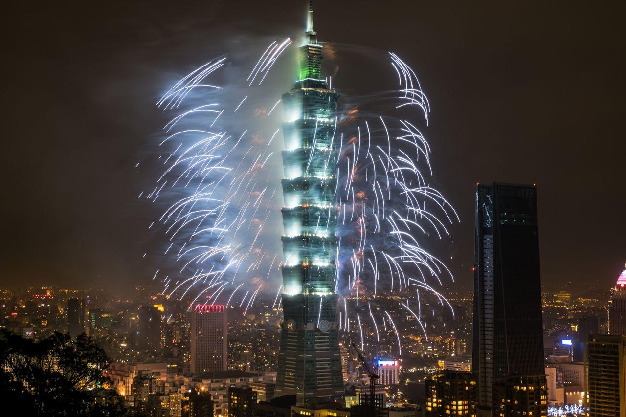 Fireworks light up the skyline in Taipei just after midnight on January 1, 2018.