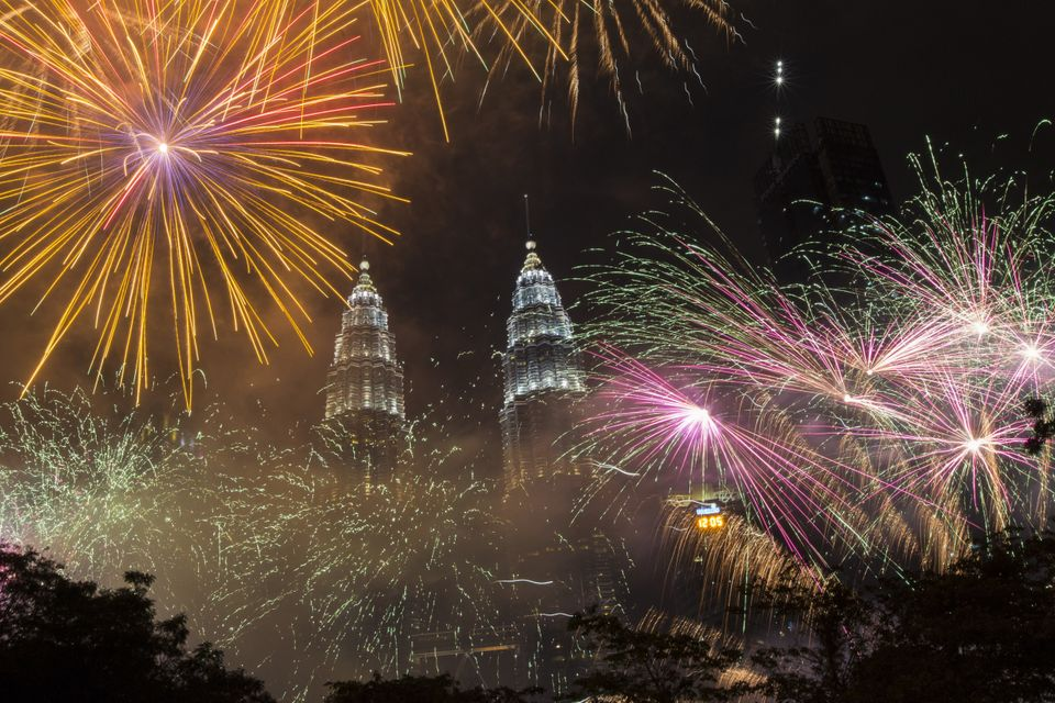 Fireworks light up the sky over Petronas Towers during New Year's celebrations in Kuala Lumpur, Malaysia...