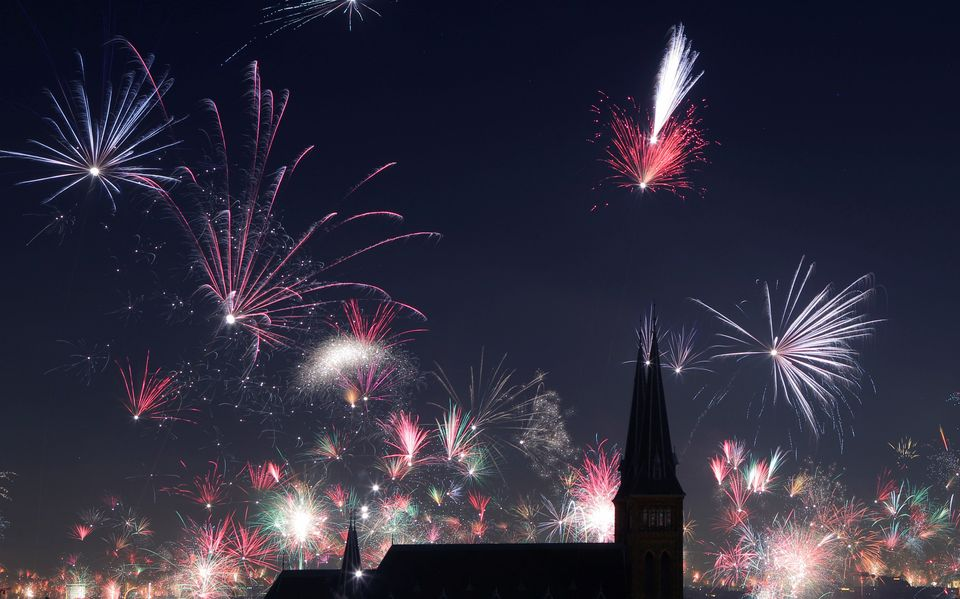 Fireworks explode around Familienkirche church during New Year's celebrations in Vienna, Austria on January...