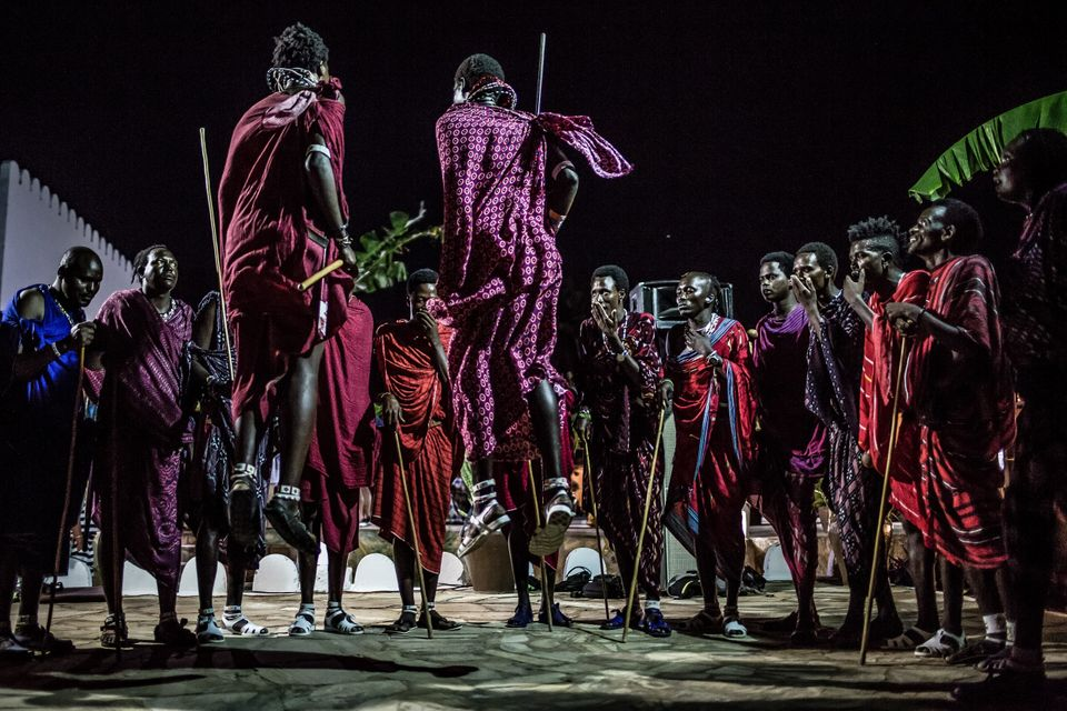 A group of Maasai tribe members perform a traditional dance during New Year's celebrations on Nungwi...