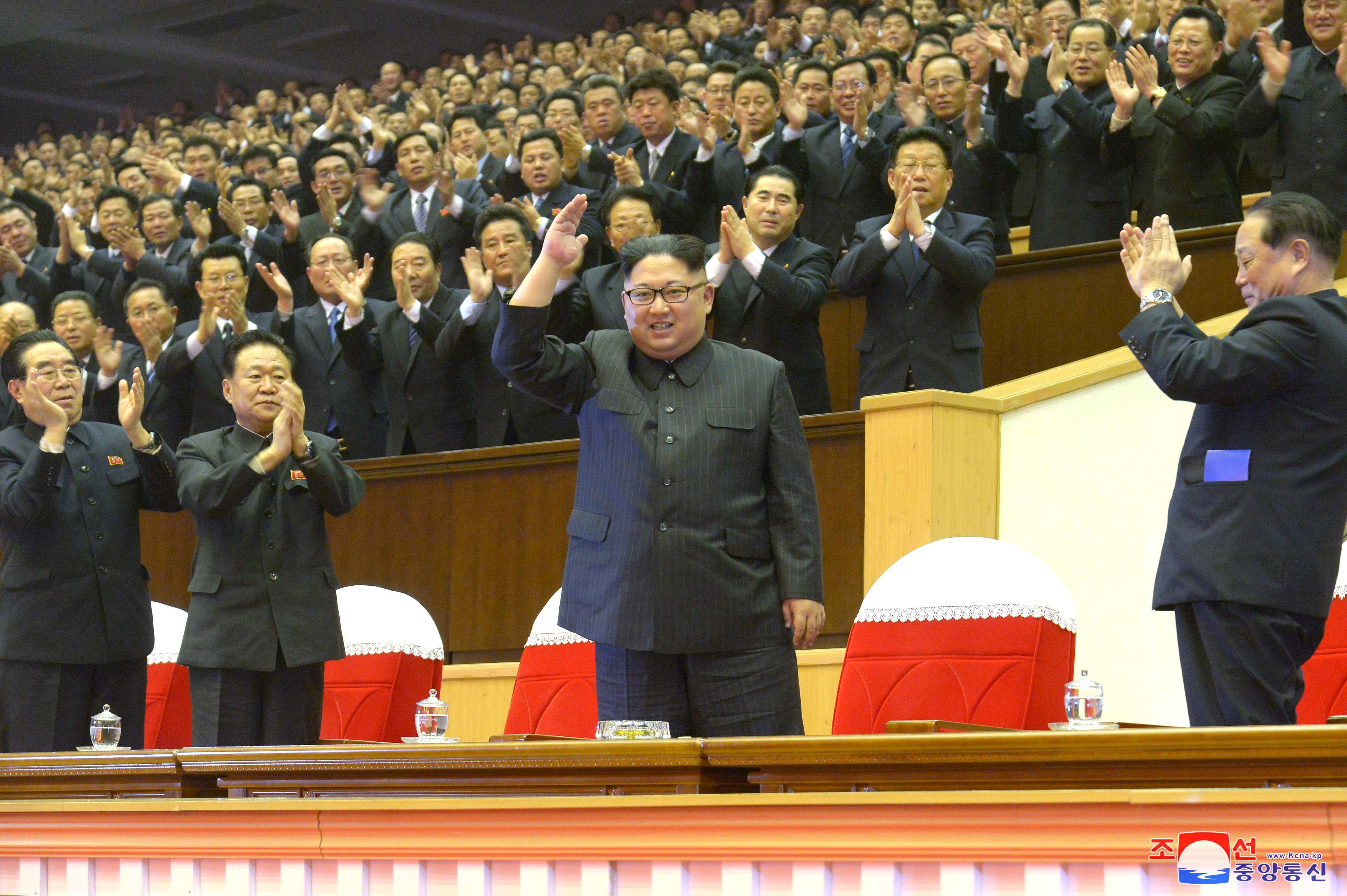 North Korean Kim Jong Un attends a music concert for the Attendants of the 5th Conference of Cell Chairpersons of the Workers' Party of Korea (WPK) held in Pyongyang on December 29 in this photo released by North Korea's Korean Central News Agency (KCNA) in Pyongyang December 30, 2017. KCNA / via REUTERS     ATTENTION EDITORS - THIS PICTURE WAS PROVIDED BY A THIRD PARTY. REUTERS IS UNABLE TO INDEPENDENTLY VERIFY THE AUTHENTICITY, CONTENT, LOCATION OR DATE OF THIS IMAGE. NO THIRD PARTY SALES. NOT FOR USE BY REUTERS THIRD PARTY DISTRIBUTORS. SOUTH KOREA OUT.     TPX IMAGES OF THE DAY