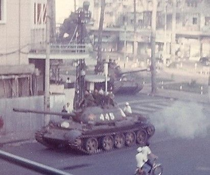 May 1, 1975 North Vietnamese tank turns from Lam Son Square down Tu Do Street toward the waterfront