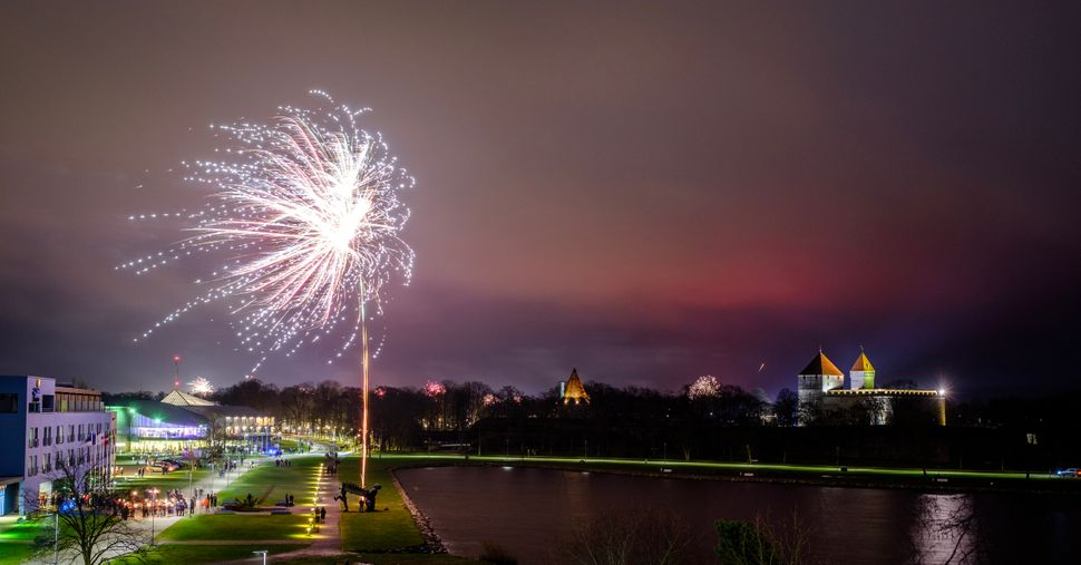 Fireworks are seen near Kuressaare Castle during New Year's celebrations.