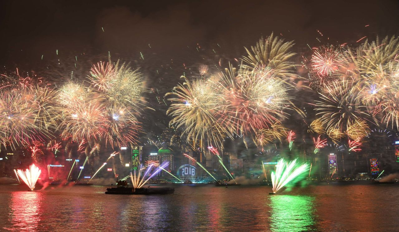 Fireworks explode over Victoria Harbour on New Year's Eve in Hong Kong, China.