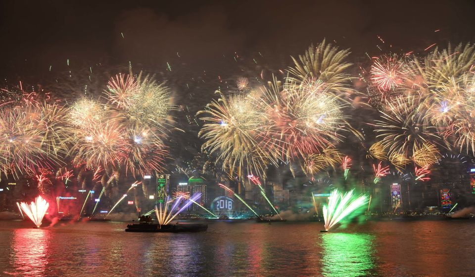 Fireworks explode over Victoria Harbour on New Year's Eve in Hong Kong,