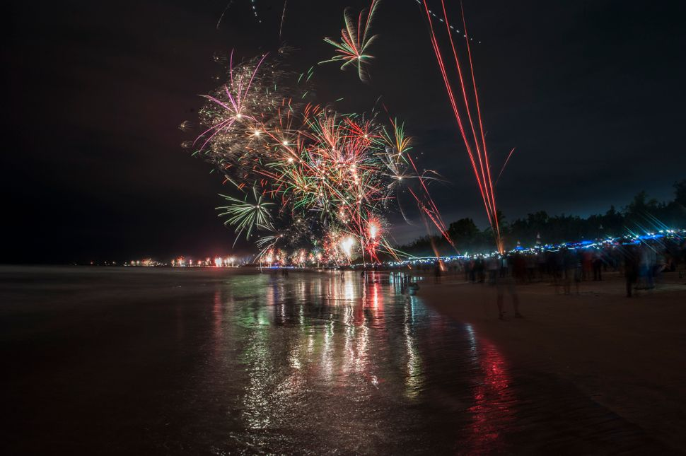 Festive fireworks welcome the new year at Kuta beach in Bali, Indonesia on January 1, 2018.