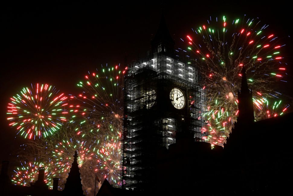Fireworks explode behind Big Ben during New Year's celebrations in London on January 1, 2018.