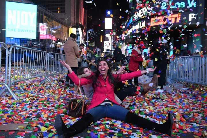 Revelers play in confetti in Times Square during the New Year's Eve celebration.