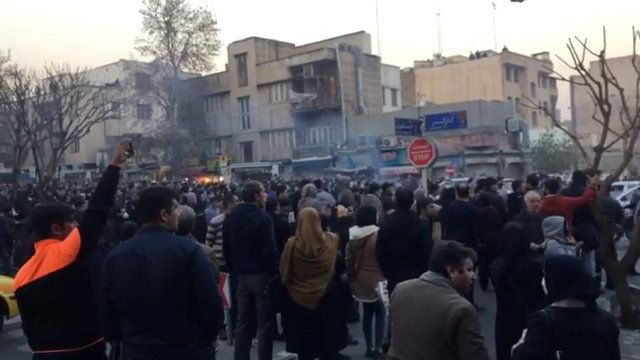 People protest in Tehran, Iran on December 30, 2017 in this still image from a video obtained by Reuters. (Reuters)