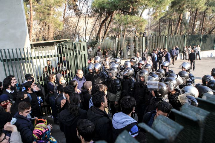 Iranian students scuffle with police at the University of Tehran during a demonstration driven by anger over economic problem