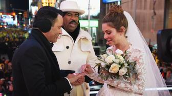 NEW YORK, NY - DECEMBER 31:  Steve Harvey (C) attends as Keven Undergaro (L) and Maria Menounos have their wedding ceremony during Maria Menounos and Steve Harvey Live from Times Square at Marriott Marquis Times Square on December 31, 2017 in New York City.  (Photo by Dimitrios Kambouris/Getty Images for MM)