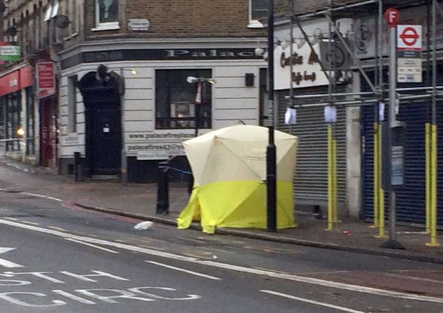 A police tent is erected in Norwood Road in Tulse Hill, south London after a 17 year old boy died after...