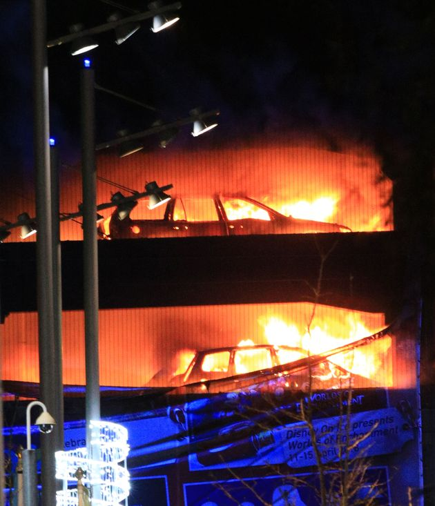 Vehicles burn during a blaze at a multi-storey car park at the Echo Arena on Liverpool's