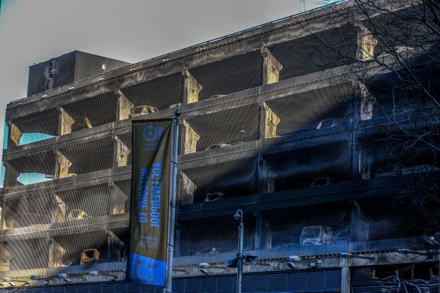 Burnt out cars seen at the multi-storey car park near the Echo Arena in Liverpool, after last night's...