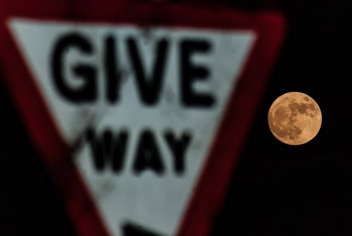 The first supermoon of the year, as seen appearing in Leominster, England.