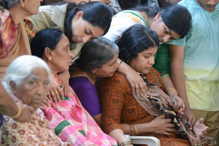 Sunayana Dumala (R), wife of the slain Indian engineer Srinivas Kuchibhotla is consoled by family members prior to perfo