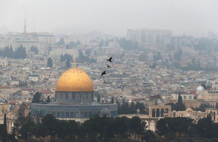 Birds fly on a foggy day near the Dome of the Rock, located in Jerusalem's Old City on the compound known to Muslims as Noble