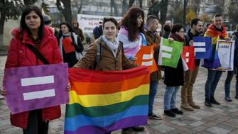 Gay rights activists attend a rally outside the parliament building in Kiev, Ukraine, November 12, 2015. Activists are pushing parliament to adopt bills, including one that would ban discrimination in the workplace based on sexuality, which is included in a package of laws to liberalise Ukraine's visa regime with the EU. REUTERS/Gleb Garanich