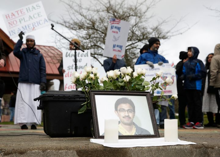 A photo of Srinivas Kuchibhotla, the 32-year-old Indian engineer killed at a bar in Olathe, Kansas, is pictured during a peac