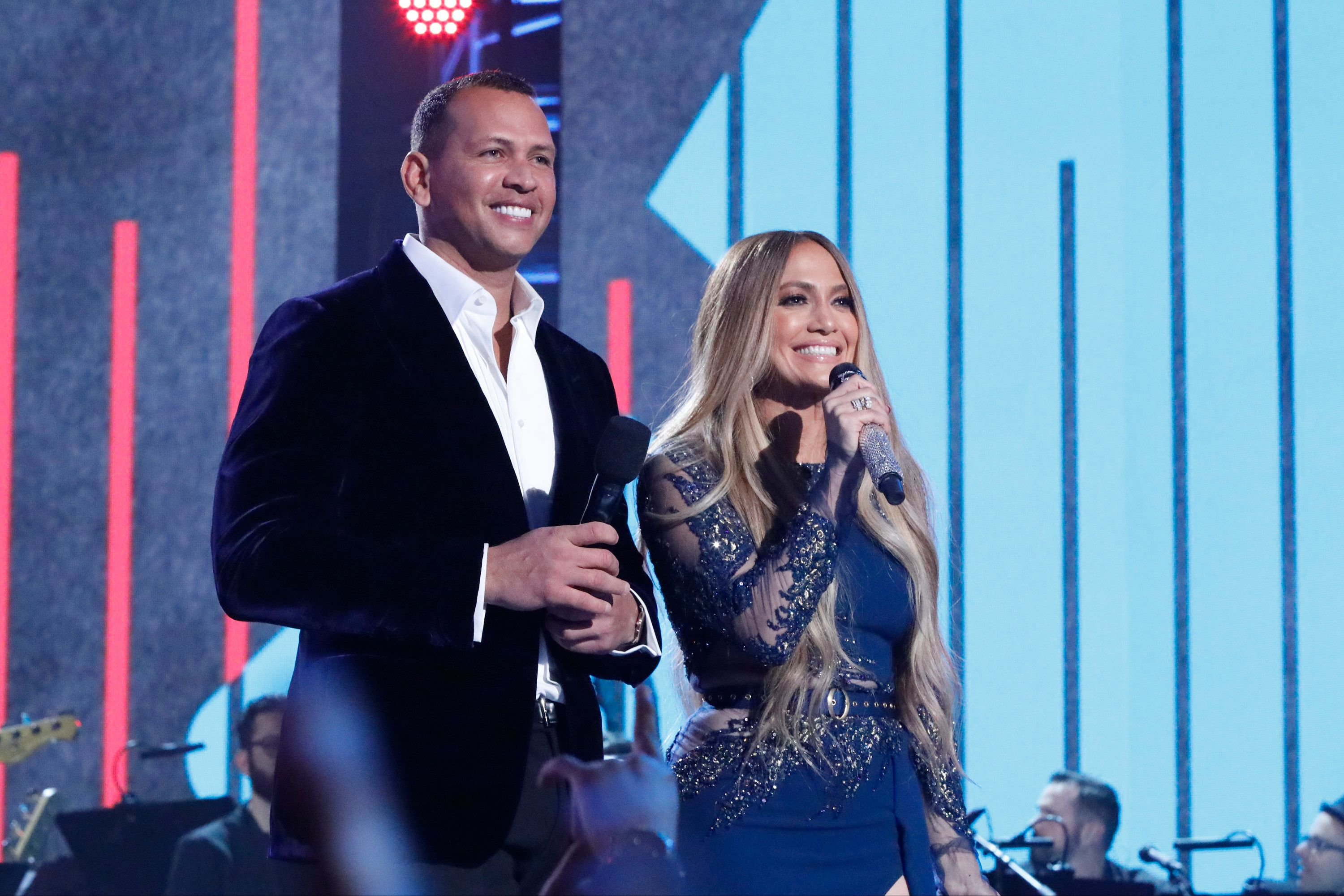 LOS ANGELES, CA - OCTOBER 14:  In this handout photo provided by One Voice: Somos Live!,  (l-r) Alex Rodriguez and Jennifer Lopez participate in the phone bank during 'One Voice: Somos Live! A Concert For Disaster Relief' at the Universal Studios Lot on October 14, 2017 in Los Angeles, California.  (Photo by Evans Vestal Ward /NBCUniversal/One Voice: Somos Live!/Getty Images)